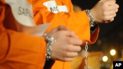 File - Prisoners at the US Guantanamo base.