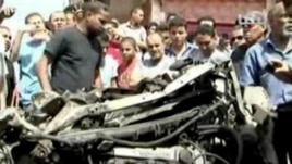 A destroyed car at scene of car bomb explosion in Benghazi, Libya, May 13, 2013