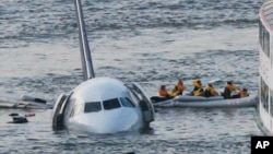 "Sully Movie Investigators: FILE - In this Jan. 15, 2009 file photo, passengers in an inflatable raft move away from an Airbus 320 US Airways aircraft that has gone down in the Hudson River in New York. Accident investigators say they object to their portrayal in a new movie based on the ""Miracle on the Hudson"" river ditching of airliner seven years ago after striking geese."