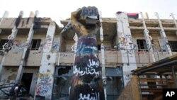 Rebel fighters walk inside Bab Al Azaziya compound in Tripoli August 26, 2011