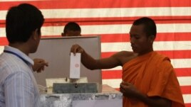 Cambodian Buddhist monk, right, casts his ballot in local elections at Wat Than pagoda's polling station in Phnom Penh, file photo.