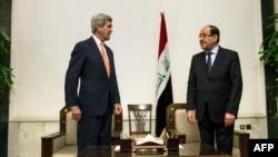 Amerika Davlat kotibi Jon Kerri, Iroq Bosh vaziri Nuri al-Mailikiy Bag'dodda. 23-iyun, 2014-yil.
