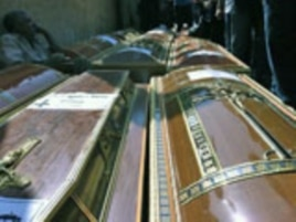 Coffins of Coptic Christian victims from Sunday's violence are readied for funeral procession, Cairo, Egypt, October 10, 2011.