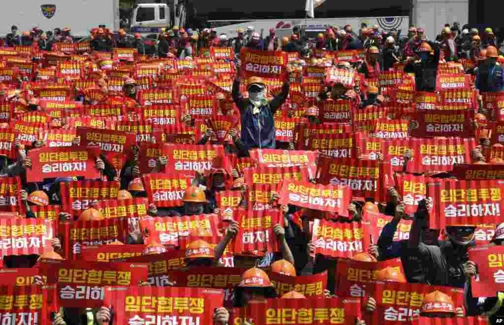 Members of the Korean Confederation of Trade Unions hold up their banners during a May Day rally in Seoul, South Korea.