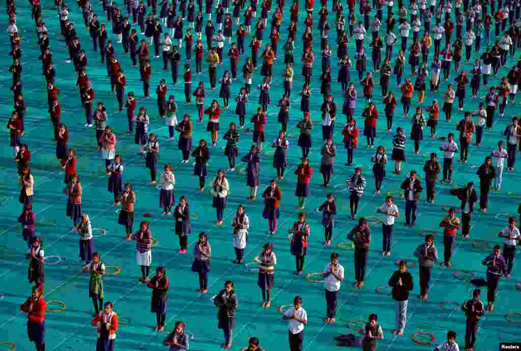 School children attend a yoga session on the last day of a week-long camp in Ahmedabad, India.