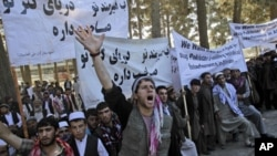 An Afghan man shouts anti-Pakistan slogans during a rally, protesting against Pakistan's interference in Afghanistan, in Kabul, Afghanistan, Sunday Oct. 2, 2011.