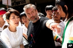"Michelle Yeoh with the director, Luc Besson on the set of ""The Lady"""