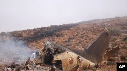 A view of the wreckage of a military transport plane after it crashed near Goulmim in southern Morocco, July 26, 2011