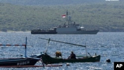 Indonesian Navy ship KRI Singa sails to take part in the search for submarine KRI Nanggala that went missing while participating in a training exercise on Wednesday, off Banyuwangi, East Java, Indonesia, Thursday, April 22, 2021. (AP Photo)