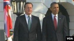 Presiden Obama bersama Perdana Menteri Inggris David Cameron di Gedung Putih (14/3).