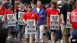 Verizon workers picket outside of the company's New England headquarters in Boston, Sunday, Aug. 7, 2011. Forty-five thousand Verizon Communications Inc. workers from Massachusetts to Washington, D.C., went on strike Sunday after negotiations fizzled ove
