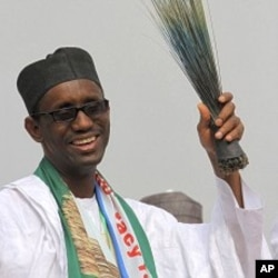Former anti-graft chief and presidential flagbearer Nuhu Ribadu with a broom, a party symbol, reacts after his announcement as a consensus candidate during the presidential primaries of Action Congress of Nigeria (ACN) in Lagos, 14 Jan 2011.