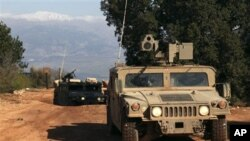 Israeli soldiers on patrol along the Israel-Lebanon border, near Yiftah in the upper Galilee region, 13 Jan 2011