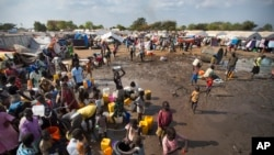 Hundreds of internally displaced persons (IDP) at a U.N. camp in Juba gather around a truck carrying clean water. Part of the $133 million pledged by the United States for South Sudan on June 16, 2015, will be used to provide water and sanitation to IDPs and refugees.