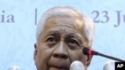 Philippine Secretary of Foreign Affairs Albert Del Rosario listens to a question during a press conference in Nusa Dua, Bali, Indonesia, July 20, 2011