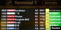 A flight information signboard shows the status of AirAsia flight QZ 8501 from the Indonesian city of Surabaya to Singapore at Changi Airport in Singapore, Dec. 28, 2014.