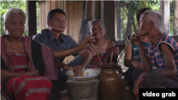 "A picture screenshot from the documentary video ""Our Tribe-Our Heritage"" shows a group of elders with their chin tattooed."