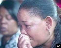 Elizabeth Mohajane weeps at the funeral of her sister, Johanna