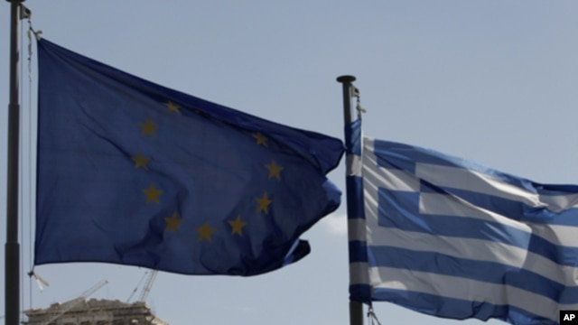 European Union flag, left, alongside Greek flag, Parthenon temple in Athens, April 11, 2011 (file photo).