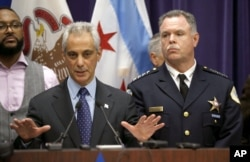 FILE - Chicago Mayor Rahm Emanuel, left, and Police Superintendent Garry McCarthy appear at a news conference in Chicago, Nov. 24, 2015.
