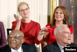 Medal of Freedom recipients include, clockwise from upper left, actresses Meryl Streep and Marlo Thomas, economist Robert Solow and golfer Charles Sifford.