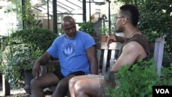 Ryan Taylor, left, and Anthony Dixon at Jefferson Market Garden in New York's Greenwich Village. (R. Taylor/VOA)