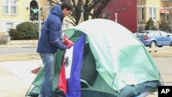 Jesse Sullivan has been camping out in the cold near a busy intersection in Washington to raise awareness for people in Haiti