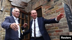 Liberal Democrat leader Tim Farron, right, and former Business Secretary Vince Cable, left, campaign for the forthcoming general election, in Twickenham, Britain, June 7, 2017.