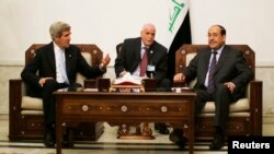 John Kerry û Nûrî El Malikî li Bexdayê, 24'ê Adarê, 2013.
