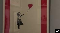 « دختر با بادکنک» اثر بنکسی Girl with Balloon