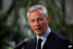 FILE - France's Finance Minister Bruno Le Maire speakes at Bercy ministry, in Paris, May 15, 2018.
