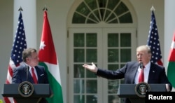 U.S. President Donald Trump, right, and Jordan's King Abdullah II hold a joint news conference in the Rose Garden at the White House in Washington, April 5, 2017.