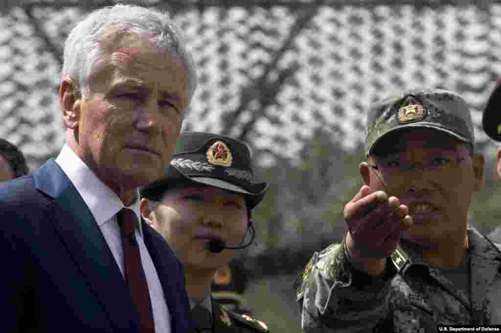 Secretary of Defense Chuck Hagel is given a tour by a Chinese military officer at the Non-Commissioned Officer Academy in Beijing, China, April 9, 2014. (Department of Defense)