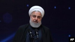 "FILE - Iranian President Hassan Rouhani is pictured speaking during a ceremony commemorating ""National Day of Nuclear Technology,"" in Tehran, April 9, 2019."