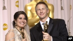 Sharmeen Obaid-Chinoy, left, and Daniel Junge pose with their awards for best documentary short for 'Saving Face' during the 84th Academy Awards in the Hollywood section of Los Angeles, February 26, 2012.