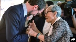 U.N. High Commissioner for Human Rights Zeid Ra'ad Al Hussein, left, is greeted by former South Korean comfort woman Kim Bock-dong, who was forced to serve for the Japanese troops as a sexual slave during World War II, as he visits the War and Women's Human Rights Museum in Seoul Wednesday, June 24, 2015. The United Nations opened a new office in Seoul on June 23 to monitor the human rights situation in North Korea. (Jung Yeon-je/Pool Photo via AP)