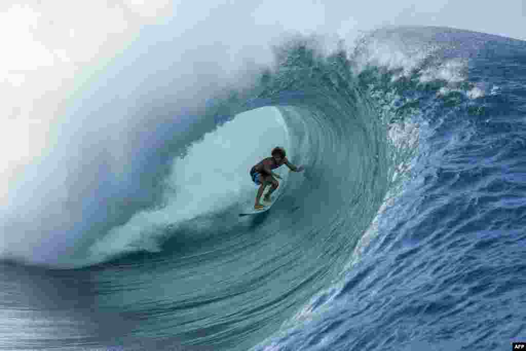 22 year-old Matahi Drollet surfs at Teahupoo off the coast of Tahiti in French Polynesia, May 11, 2020.