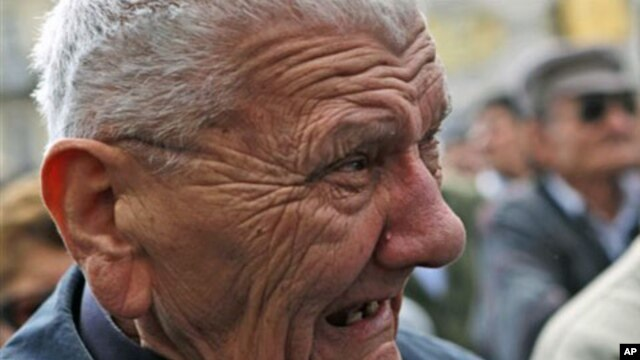 A man reacts as he watches a live broadcast of the verdict from the Yugoslav war crimes tribunal in The Hague in Zagreb, Croatia, April 15, 2011