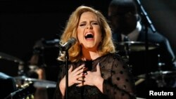"""FILE - Adele performs """"Rolling in the Deep"""" at the 54th annual Grammy Awards in Los Angeles, Calif."""
