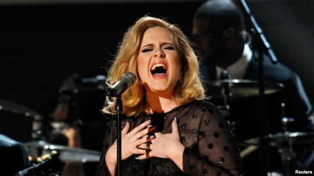 "FILE - Adele performs ""Rolling in the Deep"" at the 54th annual Grammy Awards in Los Angeles, Calif."