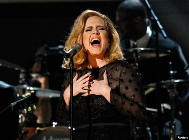 "FILE - Adele performs ""Rolling in the Deep"" at the 54th annual Grammy Awards in Los Angeles, California."