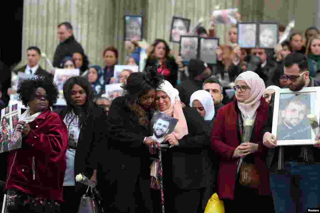 Mourners pay their respects to the victims of the Grenfell Tower fire outside St. Paul's Cathedral in London.