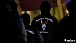 Members of a vigilante group calling themselves 'Soldiers of Odin' are seen at a rally in Joensuu, eastern Finland, January 8, 2016.