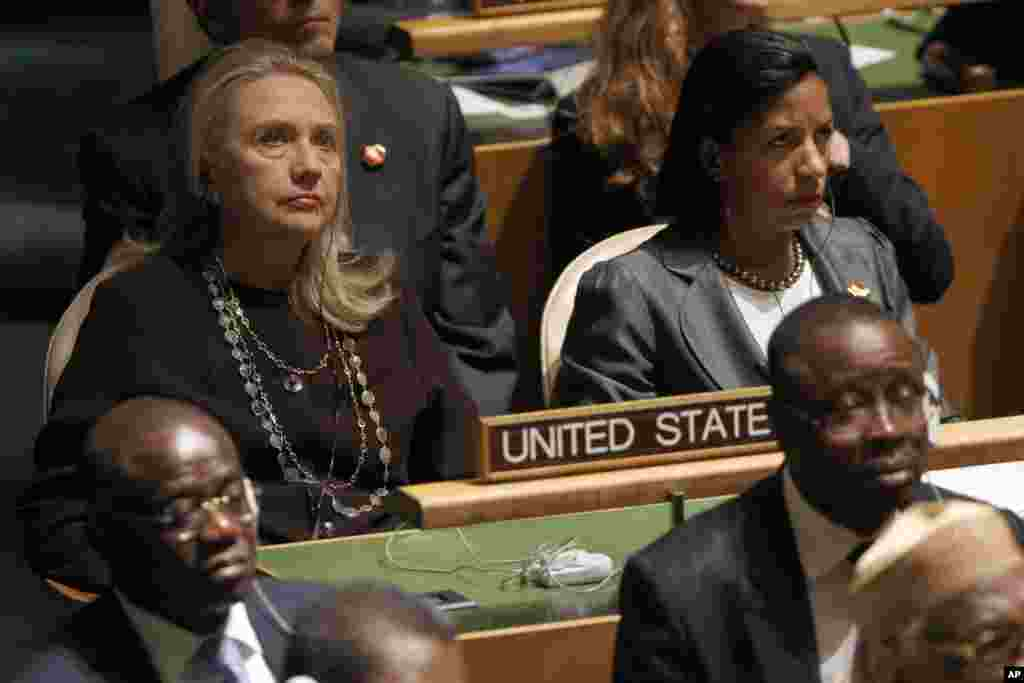 U.S. Secretary of State Hillary Clinton, left, and U.S. Ambassador to United Nations Susan Rice listen as President Barack Obama addresses the 67th session of the United Nations General Assembly, September 25, 2012.