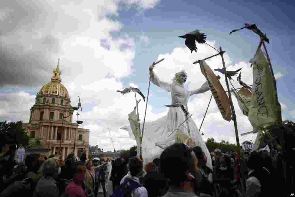 A giant puppet is paraded during a demonstration of hospitals workers, in Paris, France.