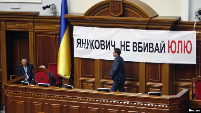 Ukrainian opposition deputies block the podium to protest against the imprisonment of former opposition leader Yulia Tymoshenko during a parliament session in Kiev, April 25, 2012.