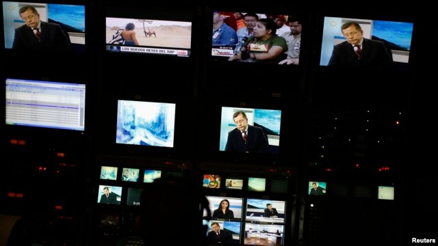 Screens are seen at the master control room of TV station Globovision in Caracas, May 28, 2013.
