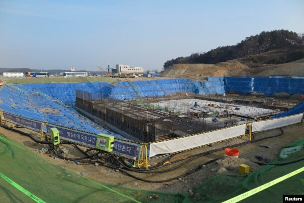 FILE - A general view of the construction site of Gangneung Ice Arena which will be a venue for the figure skating and short track competitions during the 2018 Winter Olympic Games, in the coastal cluster of PyeongChang.