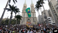 Protesters gather in front of the Metropolitan Cathedral in Sao Paulo, Brazil, June 18, 2013
