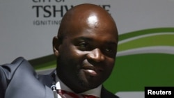 Solly Msimanga of the Democratic Alliance smiles at his supporters after being officially installed as the new mayor of Tshwane, South Africa, Aug. 19, 2016.